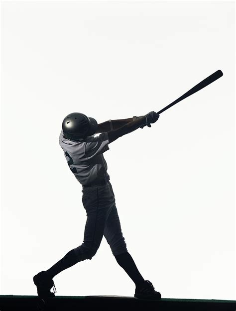swinging baseball bat silhouette of baseball batter swinging bat side view