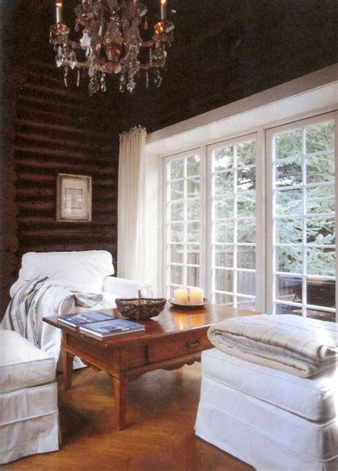 dark wood log cabin white trim white furniture the chandelier soooo unexpected log