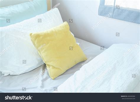 comfy bed pillows yellow pillow lay on comfy bed stock photo 609456584