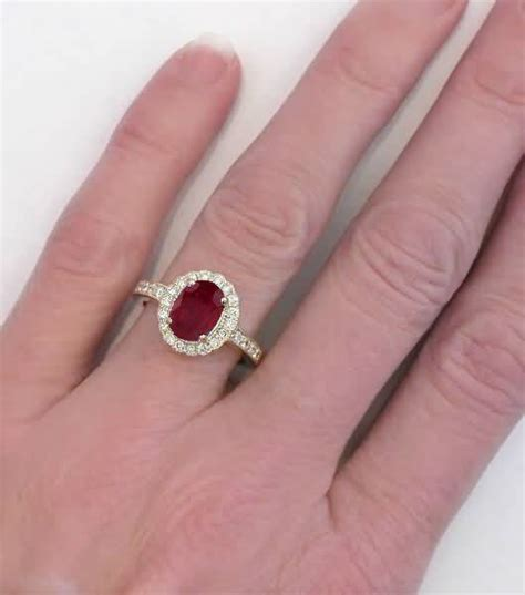Oval Ruby and Diamond Halo Engagement Ring in 14k yellow