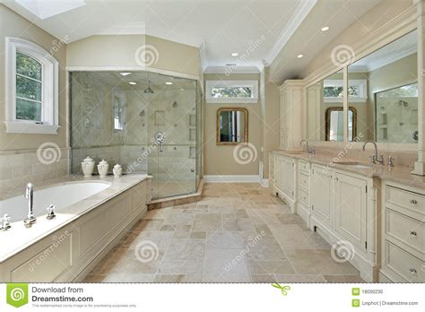 Over The Bath Showers master bath with large glass shower stock photo image