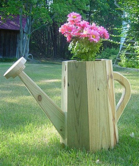 get the plans for this watering can planter from
