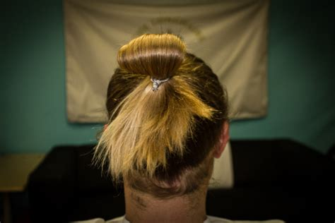 hairstyle using rubberbainds and folding hair through to create braid how to tie your long hair for men the longhairs