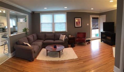 sectional sofa in front of window facing fireplace corner diagonal front door and fireplace