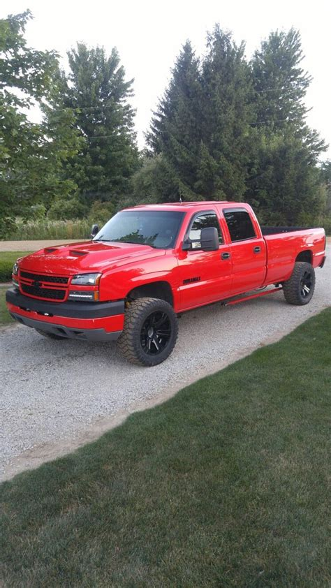 lifted gmc red my 2003 duramax red stance wheels diesel lifted