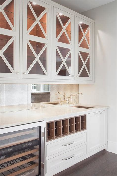 upper kitchen cabinets with glass doors stacked wine racks over mini glass door wine fridge
