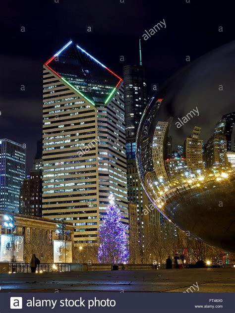 the chicago christmas tree is seen in millennium park