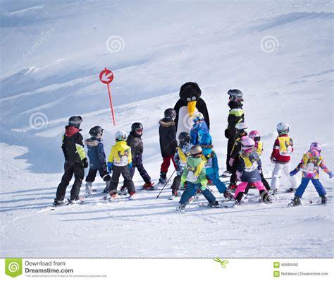 Ski School School ski instructor in a penguin suit studies children in ski