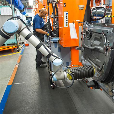 bmw factory robots smart robots can now work right next to auto workers mit