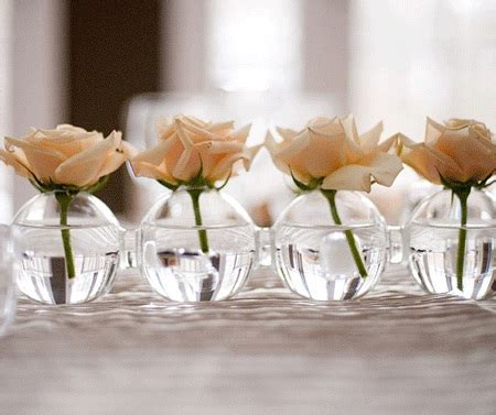 Single Flower in Light Bulb Centerpieces