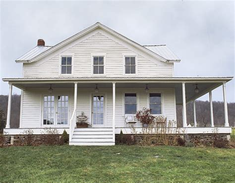 farmhouse wrap around porch i pretty stunning farmhouse from country living