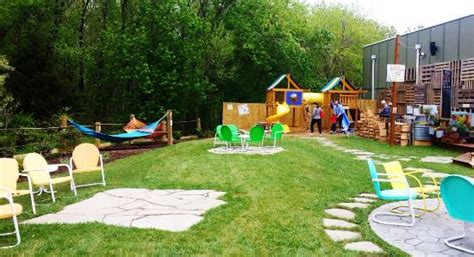 backyard brewery outdoor beer garden with playground picture of crooked hammock brewery restaurant