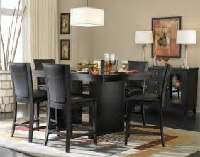 Unique black dining room set with square table and leather chairs plus