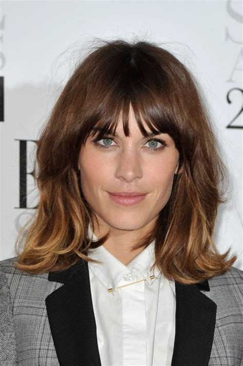 above shoulder shag layered bob with bangs layered shoulder length shag with a long swept away fringe