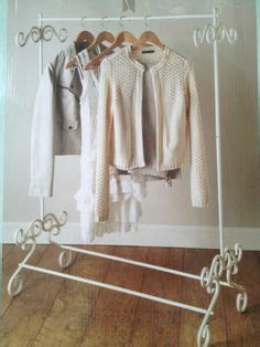 white vintage clothes cloth clothing hanging rail rack