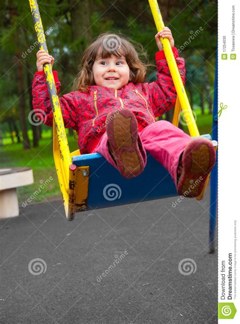 new to swinging girl swinging on a swing stock photo image 17254030