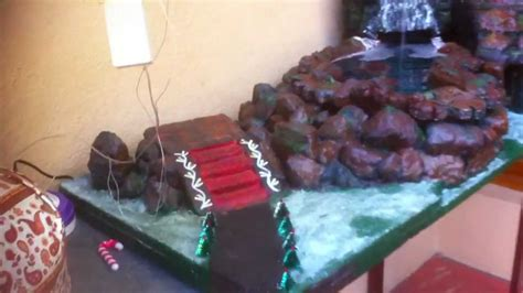 christmas crib decoration with a rain forest waterfall