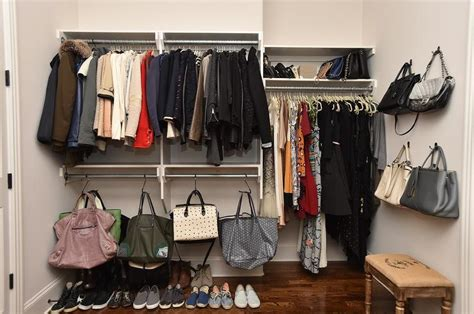 walk in closet with wall mount bag hooks transitional