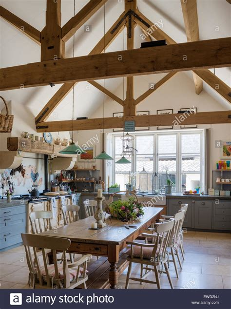 Vintage farmhouse table in rustic kitchen with green