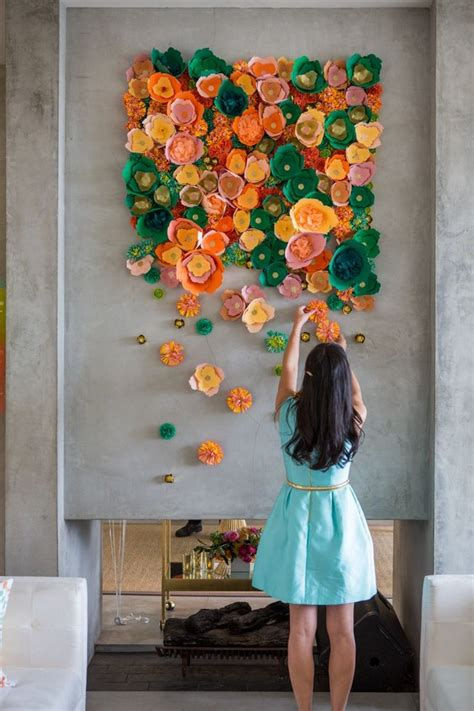 arranging diy wall and crafts with orange and green