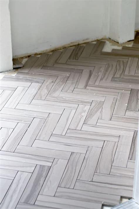 herringbone bathroom floor tile sarah m dorsey designs two weekends herringbone tile hilton head bathroom