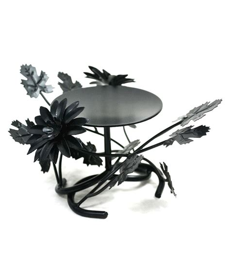 how black wrought iron adds definition to a living room srm black wrought iron candle stands buy srm black