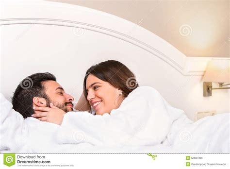 cute couples in bed cute couple in bathrobe showing affection stock photo