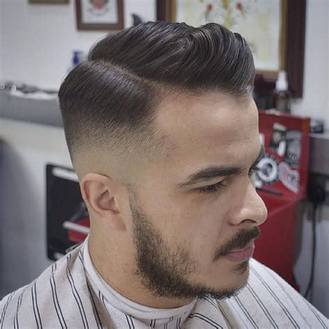hair cuts buzzed on sides and medium length in front disconnected undercut side part