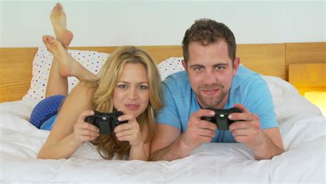 games to play in bed young couple playing video games in bed stock footage