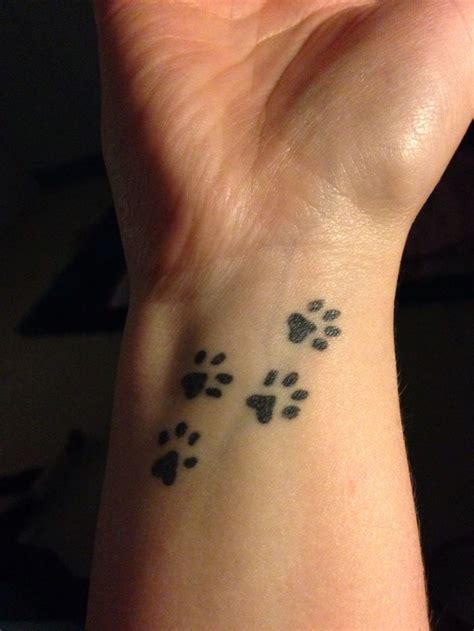 dog paw tattoo on wrist paw print tattoos designs ideas and meaning tattoos
