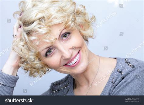this pretty blond haired middle aged stock photo 86043952 smiling face middleaged blonde pretty woman stock photo