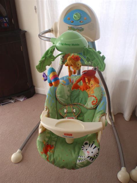fisher price rainforest open top cradle swing macam macam ada fisher price rainforest open top cradle swing