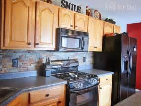 Slate tiles oak cabinets and black appliances on pinterest