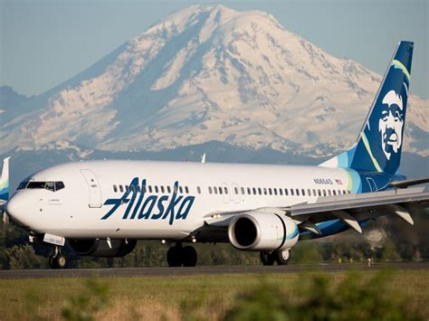 alaska airlines america begin merger process