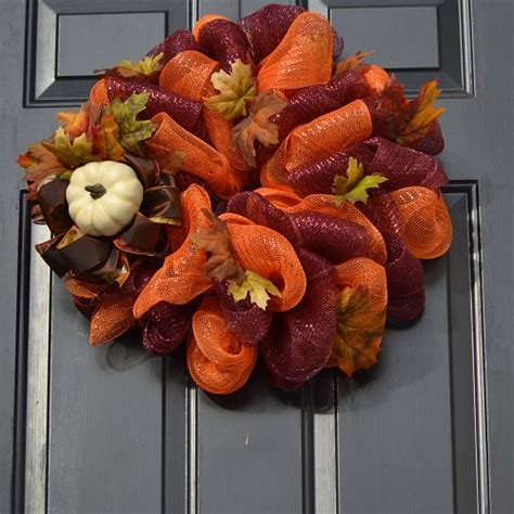 welcoming fall   front door    wreaths