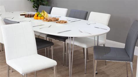 White Extendable Dining Table And Chairs White Oval Extending Dining Table Quilted Faux Leather Dining Chairs