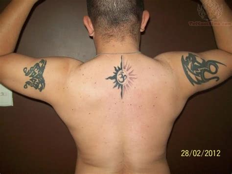 tribal ohm tattoo om on upperback and tribal on half sleeve