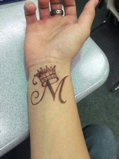 tattoo for alphabet m wrist tattoo letter m with a crown crown means self