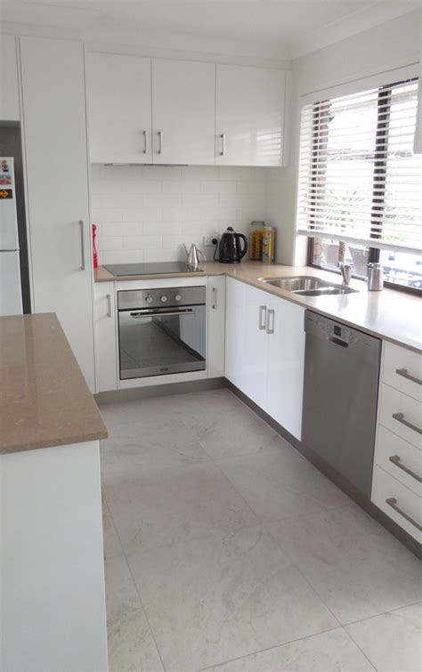 kitchen renovation brisbane with caesarstone benchtops and before and after complete renovation solutions