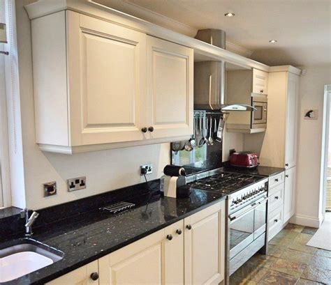 Shaker Kitchen With Granite Worktops by Shaker Kitchen Pale Units Black Granite Worktops