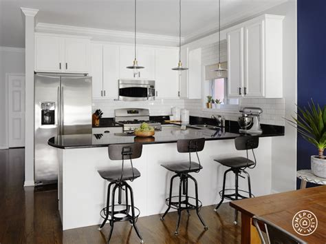 Kitchen Backsplash Ideas For White Cabinets kitchen peninsula with curved countertop transitional