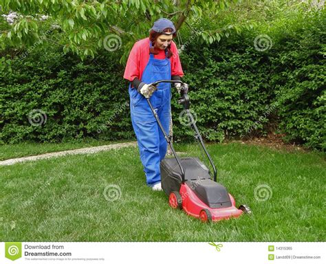 Landscaper Work Clothes A In Work Clothes Cutting The Grass Royalty Free
