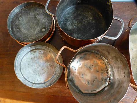 decorative polished set of two stock pots and stewing pot