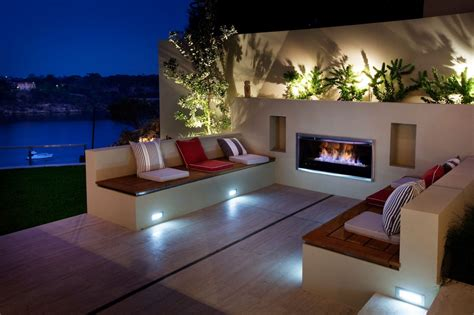 Eye catching modern outdoor fireplaces turn the patio into a dreamy