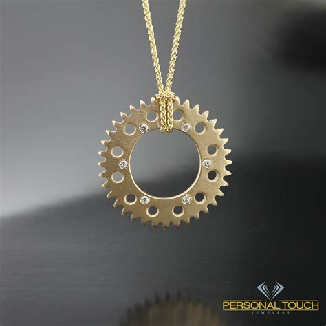 14kt yellow gold motorcycle sprocket necklace from