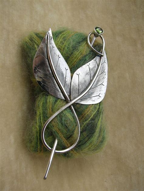 Handmade Shawl Pins - swirl two leaf shawl pin with peridot accesorsize