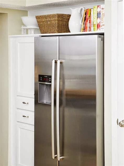 over the refrigerator cabinet how to maximize the space above the fridge refreshed designs