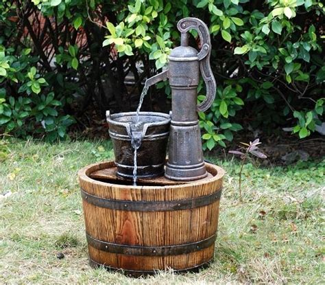 pump on wooden barrel water feature gardensite co uk