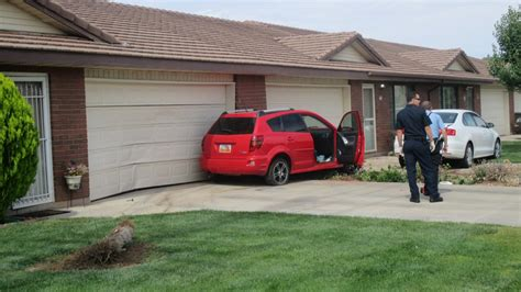Car Crash Garage by One Taken To Hospital After Car Jumps Curb Hits Home St