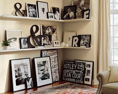 how to arrange pictures on a wall without frames creating a photo wall display jenna burger